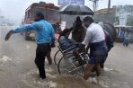 Chennai: Patients being shifted from a flooded hospital after heavy rains in Chennai on Tuesday. PTI Photo(PTI12_1_2015_000323B)