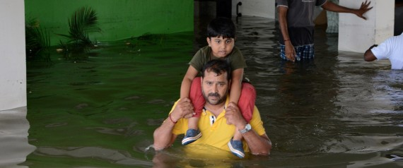 Indian rescuers carry a child to a truck as they evacuate people from a flooded residential area in Chennai on November 17, 2015. India has deployed the army and air force to rescue flood-hit residents in the southern state of Tamil Nadu, where at least 71 people have died in around a week of torrential rains. AFP PHOTO (Photo credit should read STR/AFP/Getty Images)